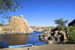 Moon and Kayak at Watson lake. The full moon rising over scenic watson lake near prescott arizona with interesting granite rock formations and a kayak on the Stock Photography