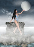 Moon keeper. Beautiful night fairy with water wings holding moon Stock Photo