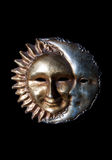 The moon kissing the sun. An italian mask of the sun and the moon Stock Images