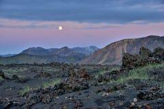 Moon la regolazione nelle colline Immagine Stock