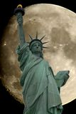 Moon lady. Statue of Liberty with moon in background Royalty Free Stock Image