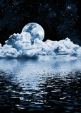 Moon Lake. The moon setting over clouds and water with reflections Royalty Free Stock Photos