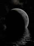 Moon Lake. The moon rising above a lake Royalty Free Stock Image