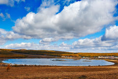 The moon lake and cloudscape in grassland Stock Photo