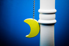 Moon on lamp pull chain. Moon cutout on pull chain of child's bedroom light royalty free stock image