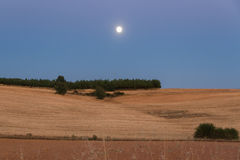 Moon in Landscape at Dusk Stock Images
