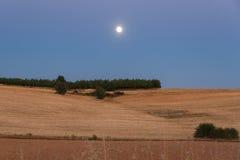 Moon in Landscape at Dusk Stock Images
