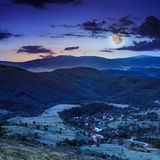 Moon light falls on hillside with autumn forest in mountain Royalty Free Stock Image