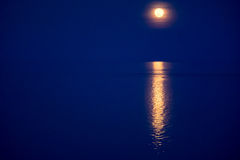 Moon light gleam in water - beautiful background. Moon light gleam in water. Deep blue covered landscape - beautiful background royalty free stock photography