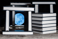 Moon light of knowledge in the darkness Stock Photo