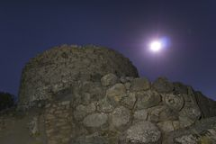 Moon light on nuraghe La Prisgiona. A nitght view of Nuraghe La Prisgiona stock photography