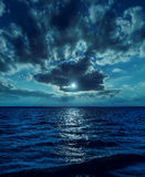 Moon light over water in night Royalty Free Stock Images