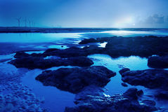 Moon light on the rock seacoast Royalty Free Stock Photos