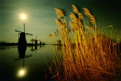 Moon light windmill. Moon back-light of traditional windmill in the Netherlands Stock Photography