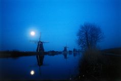 Moon light windmill. Moon back-light of traditional windmill in the Netherlands stock images