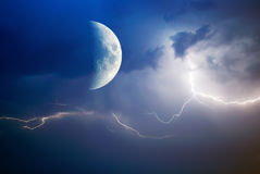 Moon and lightning stock photography