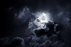The Moon. Between a lot of cloud Royalty Free Stock Images