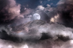 Moon on magic mountain Royalty Free Stock Image