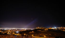 Moon and Mars. Eclipsed Moon and Mars over Mdina in Malta royalty free stock images