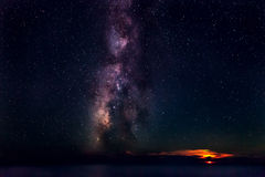 Moon & Milky Way. The Milky Way, rising out of the Mediterranean Sea, next to a setting Moon stock photos