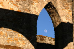 Moon and Mission San Jose. Moon viewed through an archway at Mission San Jose in San Antonio Texas Royalty Free Stock Photography