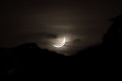 Moon and mist. Zoomed in shot of the moon, with some mist and clouds Royalty Free Stock Photo