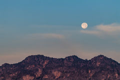 Moon in the morning over the mountain Royalty Free Stock Photography