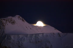 Moon and Mountain. The moon sleeps at mountain top royalty free stock images