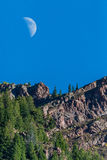 Moon and mountain summit peak Stock Images