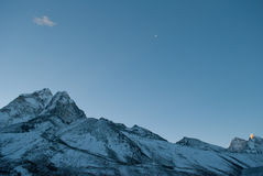 Moon and mountains. Crescent moon and the himalayan mountains Stock Photo