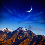 Moon and mountains royalty free stock photos