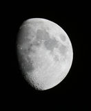 Bright Moon. 3/4 Moon in the black sky with crisp detail Stock Image