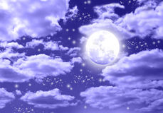 Moon at night. Moon and stars with clouds at nighttime Royalty Free Stock Photo