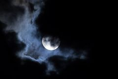 Moon night clouds. Full moon shining through dramatic clouds Stock Photos