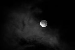 Moon in night skies covered by the cloud. Monochrome Royalty Free Stock Photos