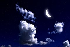 Moon in the night sky. The moon and star with cloud in the night sky Royalty Free Stock Images