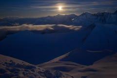 Moon night in winter mountains Stock Photo
