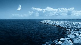 Moon on the ocean Stock Images