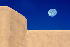 Adobe style architecture lite by an Arizona full moon. Moon over Arizona, Adobe architectural style element highlighted, by cobalt blue skies and a full autumn Royalty Free Stock Image
