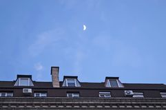Moon over the attic_01 Royalty Free Stock Photos