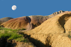 Moon over badlands Royalty Free Stock Photography