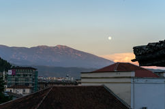 Moon over Berat. Beautiful view over berat with moon and red mountains Stock Image