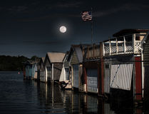 Moon over boathouses Royalty Free Stock Photos