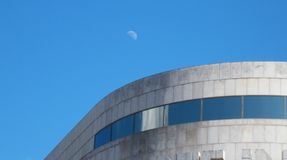 Moon over a building Stock Photography
