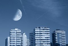 Moon over the buildings Royalty Free Stock Image