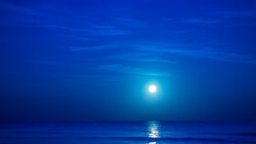 Moon over caribbean sea Stock Photography