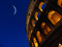 The Moon over Colosseum Royalty Free Stock Photography