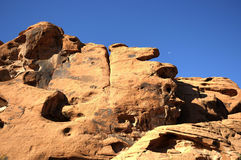 Moon over Desert rock formations Royalty Free Stock Images