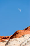 Moon over desert valley of Fire Stock Image