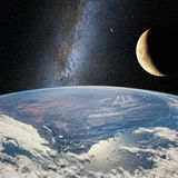 Moon over the earth, on the background of milky Way.  Elements of this image furnished by NASA http://www.nasa.gov/ Royalty Free Stock Photos